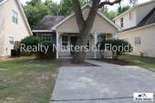 Clean ~ Updated with beautiful tiled floors~ Fenced Yard~ Desired location & schools.